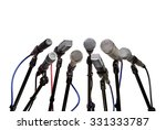 Small photo of Several microphones prepared for press conference isolated on white