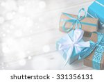 four gift boxes in wrapping... | Shutterstock . vector #331356131