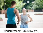 couple jogging in park at... | Shutterstock . vector #331367597