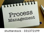Process management memo written on a notebook with pen - stock photo