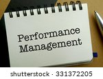 Performance management memo written on a notebook with pen - stock photo