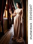 Young Woman In Beige Vintage...