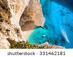 Navagio Beach With Boats On...