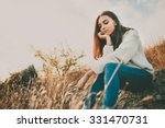 sad young girl sitting alone on ... | Shutterstock . vector #331470731