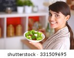 young woman eating fresh salad... | Shutterstock . vector #331509695