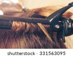 stylist curling hair for young... | Shutterstock . vector #331563095