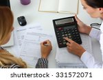 two female accountants counting ... | Shutterstock . vector #331572071