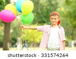 little boy with balloons in the ... | Shutterstock . vector #331574264