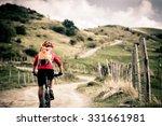 Mountain Biker Riding On Bike...
