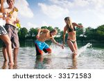 Group Of People On The Beach O...