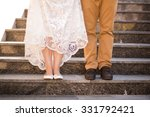 Legs Of The Groom And Bride In...