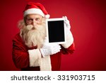 Santa With Touchpad Looking At...