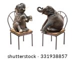 Stock photo cute baby elephant sitting on the chair isolated on white background 331938857