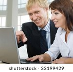 two business people using laptop | Shutterstock . vector #33199429
