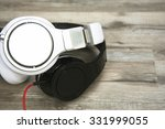 white and black headphones laid ... | Shutterstock . vector #331999055
