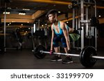 young woman lifting weights in... | Shutterstock . vector #331999709