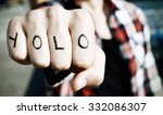 Small photo of closeup of a young man with the word yolo, for you only live once, in his knuckles, with a filter effect