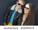 portrait of fashionable mother... | Shutterstock . vector #332099675