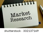 Market research memo written on a notebook with pen - stock photo