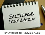 Business intelligence memo written on a notebook with pen - stock photo