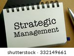 Strategic management memo written on a notebook with pen - stock photo