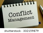 Conflict management memo written on a notebook with pen - stock photo