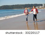 young couple running on beach... | Shutterstock . vector #33220117