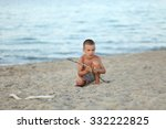 boy play with stick on beach... | Shutterstock . vector #332222825