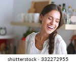 young woman standing near desk... | Shutterstock . vector #332272955