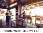 Stock photo coffee shop cafe blurred with bokeh background 332291147