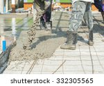 Worker Pouring Cement In...
