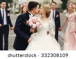 handsome brunette groom kissing ... | Shutterstock . vector #332308109