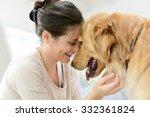 Stock photo portrait of woman with dog 332361824