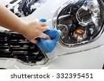 female hand washing a car with... | Shutterstock . vector #332395451