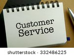 Customer service memo written on a notebook with pen - stock photo
