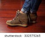 crossed legs a woman in jeans... | Shutterstock . vector #332575265