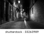 A Narrow Street At Night In...
