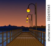 Pier At Night Illuminated By...