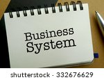 Business system memo written on a notebook with pen - stock photo