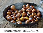 Roasted Chestnuts Served In A...