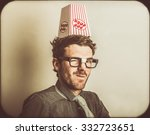 Small photo of Retro photograph of a funny movie critic wearing popcorn knowledge hat. Film nerds