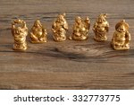 Row Of Figurines Of Laughing...