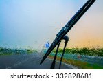 Wiper On A Wet Windshield At...