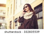 woman talking on phone outdoor | Shutterstock . vector #332835539