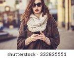woman using smart phone   Shutterstock . vector #332835551