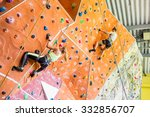 fit couple rock climbing... | Shutterstock . vector #332856707