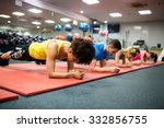 Small photo of Fit people working out in fitness class at the gym
