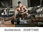 man bodybuilder   execute... | Shutterstock . vector #332877485