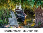 Old Boat On The Dock Among The...