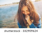 Stock photo shy girl sanding looking down cute teenage girl being shy on lake background film effect 332909624